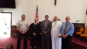 From left to right: Elder Jim Hall, Rev. Earle Sickels, Larry Hadrava, Rev. Sam McCoy, Elder Lynwood Timberlake